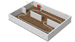 Crawl space with a drainage hose laid out